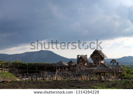 Viking-style hut on the background of nature #1314284228