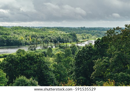 Viljandi lake in picturesque valley against stormy clouds, Estonia #591535529