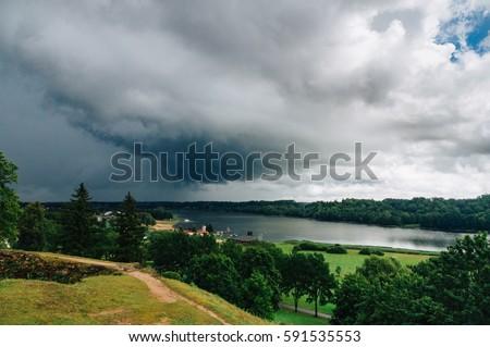Viljandi lake in picturesque valley against thunderous clouds, Estonia #591535553