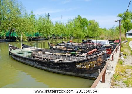 VILKOVO, UKRAINE - MAY 04, 2010: Fishing boats in Vilkovo, village on the water at the delta of Danube - the European Union's longest river - in Vilkovo, Ukraine.