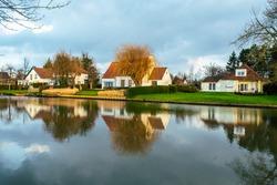 Villa houses located in Sint Martens Latem between Deinze and Ghent. Villa houses next to the river. Flanders, Belgium.