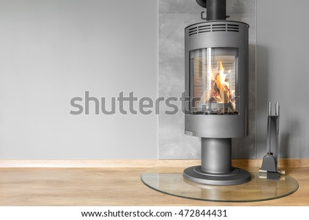 Villa interior in grey with modern fireplace and fireplace tools set #472844431