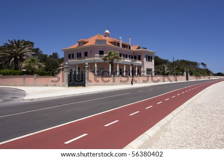 villa with cycle lane on foreground  in summer day