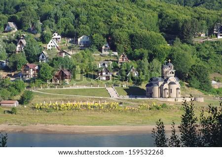 village and St. Nicholas church on Mavrovo Lake National Park, Republic of Macedonia