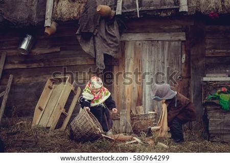 village children gather wood...