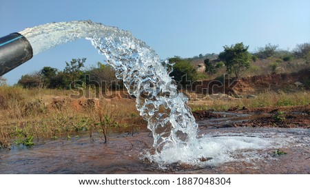 village farming bore water and village cheruv , river water water slow motion pictures, pump water slow motion pictures, dry grass