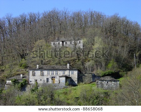 Village houses on a hill amongst trees, #88658068