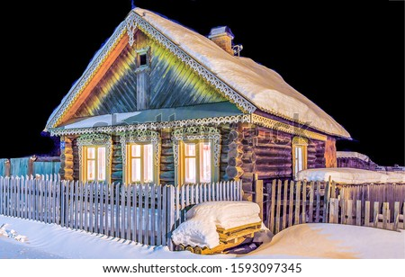 Village hut in winter snow night. Russian village house in winter snow night. Winter night in snowy village. Christmas night in winter russian village