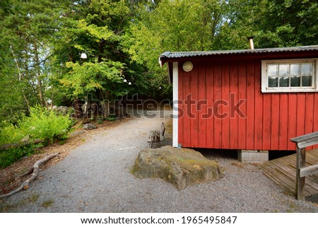 Village in a green forest. Traditional wooden house colored with falu red dye. Stockholm sail club, lake Mälaren, Sweden. Pure nature, environment ecotourism, vacations. Panoramic view Stock fotó ©
