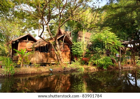 Village in tropical forest, historical park Ancient City, Bangkok, Thailand