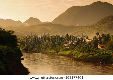 village near by river and hill, luang prabang city, laos
