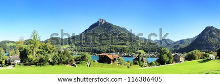 Village near the lake in the Alps mountains. Austria - stock photo