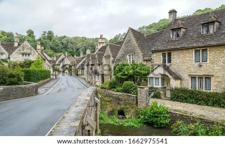 Village of Castle Combe, Wiltshire, UK. Bridge over River Bybrook Stock photo ©