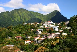 Village of Morne Vert at the foot of the Pitons du Carbet .