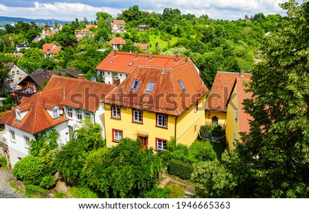 Village red roof tiles houses in green foliage top view. Red roof tiles top view landscape