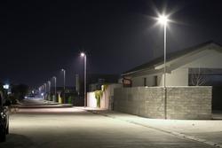 village street with modern LED streetlights at night