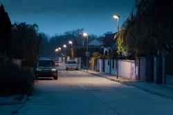 village street with modern streetlights at night