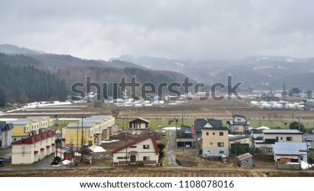 Village with mountain background