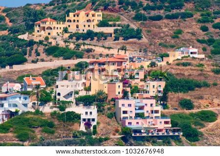 villas on the mountainside on coast #1032676948