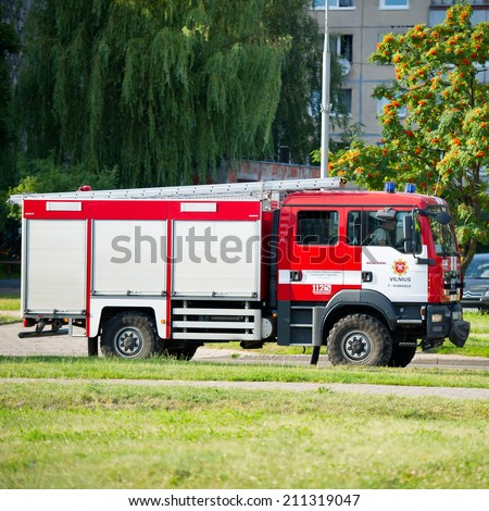 VILNIUS - JULY 25: Fire Truck MAN on July 25, 2014 in Vilnius, Lithuania. A firefighter (also known as a fireman) is a rescuer extensively trained in firefighting.