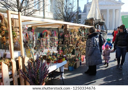 VILNIUS, LITHUANIA - MARCH 8: Unidentified people trade traditional palm bouquets in annual traditional crafts fair - Kaziuko fair on MARCH 8, 2016 in Vilnius, Lithuania #1250334676