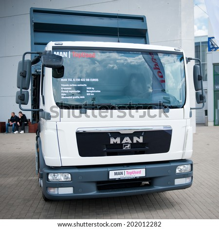 VILNIUS, LITHUANIA - MAY 9: MAN TGL 8.150 4x2 BB truck on May 9, 2014 in Vilnius, Lithuania. MAN AG, is a German mechanical engineering company. MAN supplies trucks, buses, diesel engines and turbomachinery.