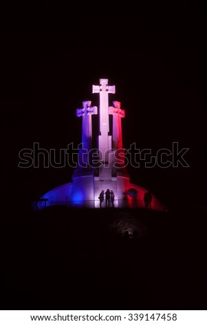 Vilnius, Lithuania - November 14, 2015: Three Crosses monument was illuminated in the French national colors last night after the terror attacks in Paris on 14 Nov, 2015 in Vilnius, Lithuania.