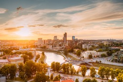 Vilnius, Lithuania. Sunset Sunrise Dawn Over Cityscape In Evening Summer. Beautiful View Of Modern Office Buildings Skyscrapers In Business District New City Centre Shnipishkes