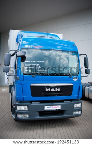 VILNIUS - MAY 9: MAN TGL 12.250 delivery truck on May 9, 2014 in Vilnius, Lithuania. MAN AG, is a German mechanical engineering company. MAN supplies trucks, buses, diesel engines and turbomachinery.