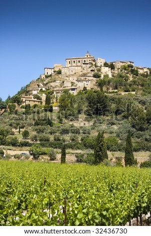 Vineyard and hilltop village of Gordes in the Luberon, Vaucluse, Provence, France