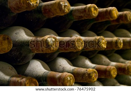 vineyard cellar with old bottles