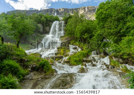 Vinnufossen, a beautiful waterfall flushing down a mountainside in Sunndal,  Norway. The tallest waterfall in Europe and the sixth tallest in the world.  865m or 2 838 ft