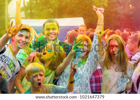 Vinnytsia / Ukraine - 06 10 2016 : Holi celebration. Students celebrating the festival of colors. Colorfull editorial photo. Painted faces. Smiling and happy people. #1021647379