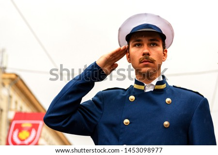 Vinnytsia, Ukraine. 22.09.2018. The man in a ceremonial uniform on salutes a hand. The soldier on a post #1453098977