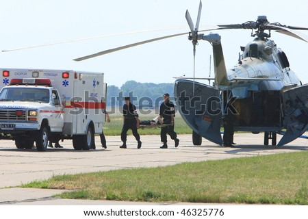 VINNYTSYA, UKRAINE - JUNE 10: Two soldiers with a hand frame  run to  emergency car during the medical military trainings on June 10, 2008 in Vinnytsya, Ukraine