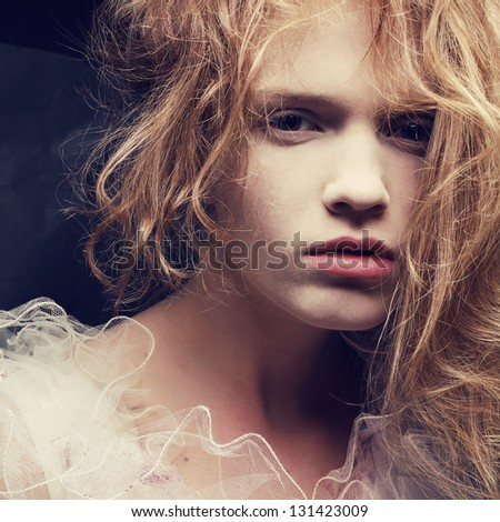 Vintage a-la french princess portrait of a beautiful blond (ginger) girl. Retro (classic) style. Close up. Studio shot.