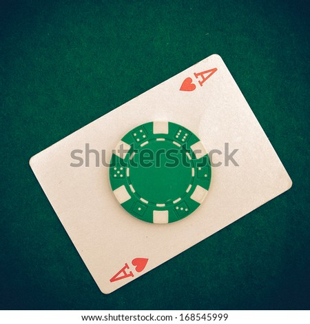 Vintage - Ace with casino chip on a green casino table with space for text