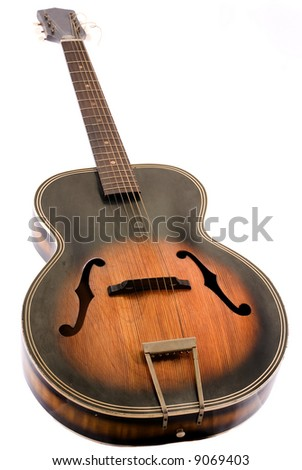 Vintage acoustic guitar on white background.