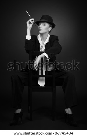 stock photo : Vintage adult woman smoking cigarette over black