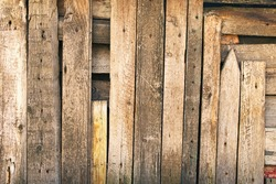 Vintage aged wooden background texture. Aged wooden planks on wall. The wall of abandoned barn. Abstract background.