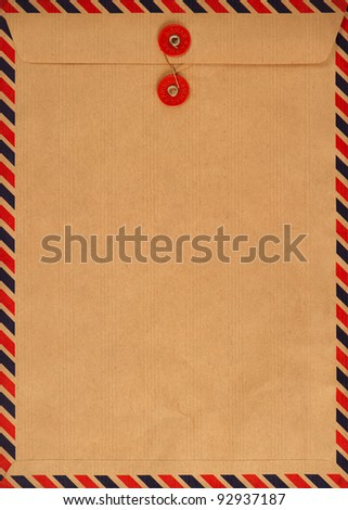 vintage airmail envelope. grungy background