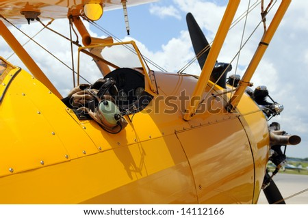 Vintage airplane detail showing cockpit and pilot gear