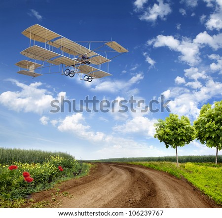 vintage airplane in flight over a field