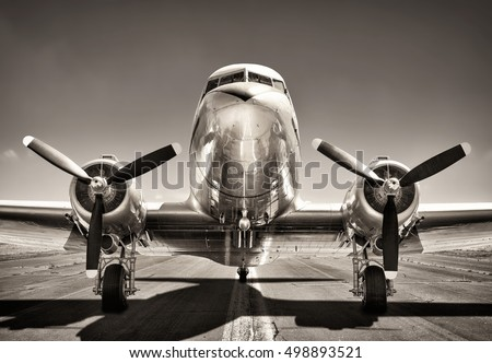 vintage airplane on a runway #498893521