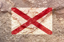 Vintage Alabama state flag icon pattern isolated on weathered solid rock wall background, abstract positive design faithful USA Alabama politics society concept texture wallpaper