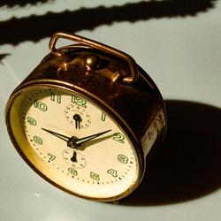 Vintage alarm clock, aged photo