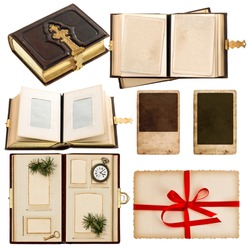 vintage album with retro photo cards. greetings card with red ribbon bow. antique book with golden decoration isolated on white background