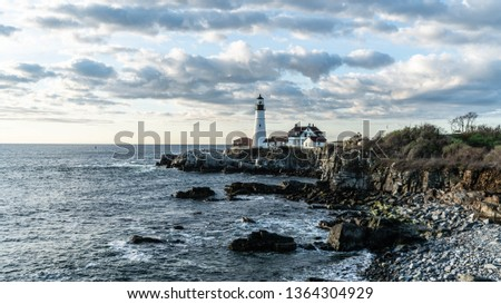Vintage America in Portland, Maine with the iconic Portland Headlight. An historic lighthouse in Cape Elizabeth, Maine. Completed in 1791, it is the oldest lighthouse in the state of Maine.