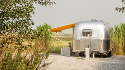 Vintage america mobile home on a camping site in the Netherlands