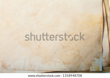 Vintage and antique background frame art concept. Front view of blank old aged dirty photo paper texture with stains and scratches. Detailed closeup studio shot #1358948708